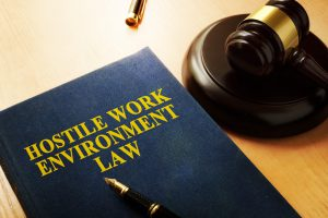 hostile work environment law book and law gavel