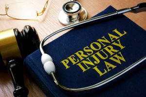 personal injury law book and stethoscope