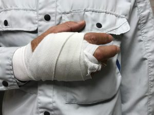 worker with injured hand